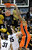 Eric Moreland of OSU dunks on Shane Harris-Tunks during the second half of the March 9, 2013 game in Boulder.    (Cliff Grassmick/Boulder Daily Camera)