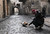 A Free Syrian Army fighter feeds a cat in the old city of Aleppo January 6, 2013. REUTERS/Muzaffar Salman