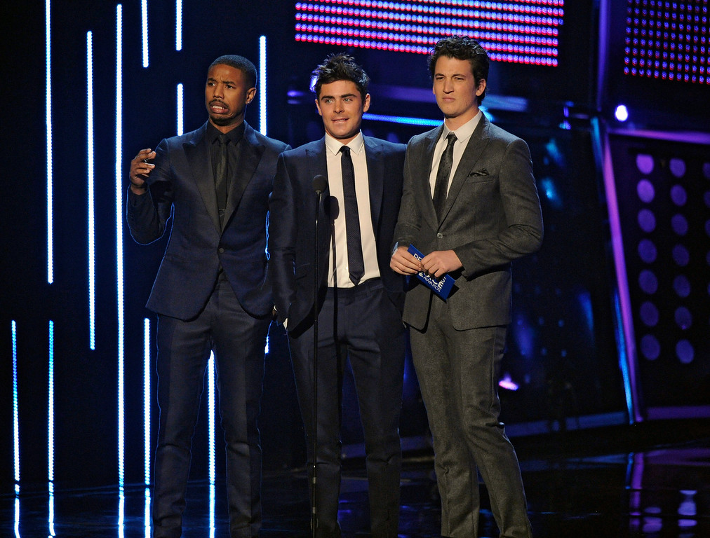 Description of . From left, Michael B. Jordan, Zac Efron and Miles Teller present the award for favorite comedic movie at the 40th annual People's Choice Awards at the Nokia Theatre L.A. Live on Wednesday, Jan. 8, 2014, in Los Angeles. (Photo by Chris Pizzello/Invision/AP)