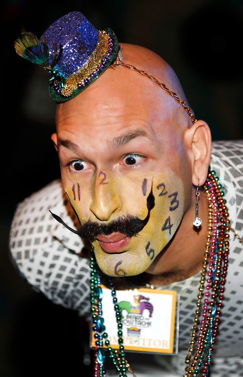 Description of . Keith Haubrich of Seattle, Wash., reacts to the crowd while competing in the Dali Moustache division during the fourth annual Just For Men National Beard and Moustache Championships Saturday, Sept. 7, 2013 in New Orleans. Haubrich went on to win the gold medal for the Dali division.Contestants competed in 18 different categories including Dali, full beard natural and sideburns.(AP Photo/Susan Poag)