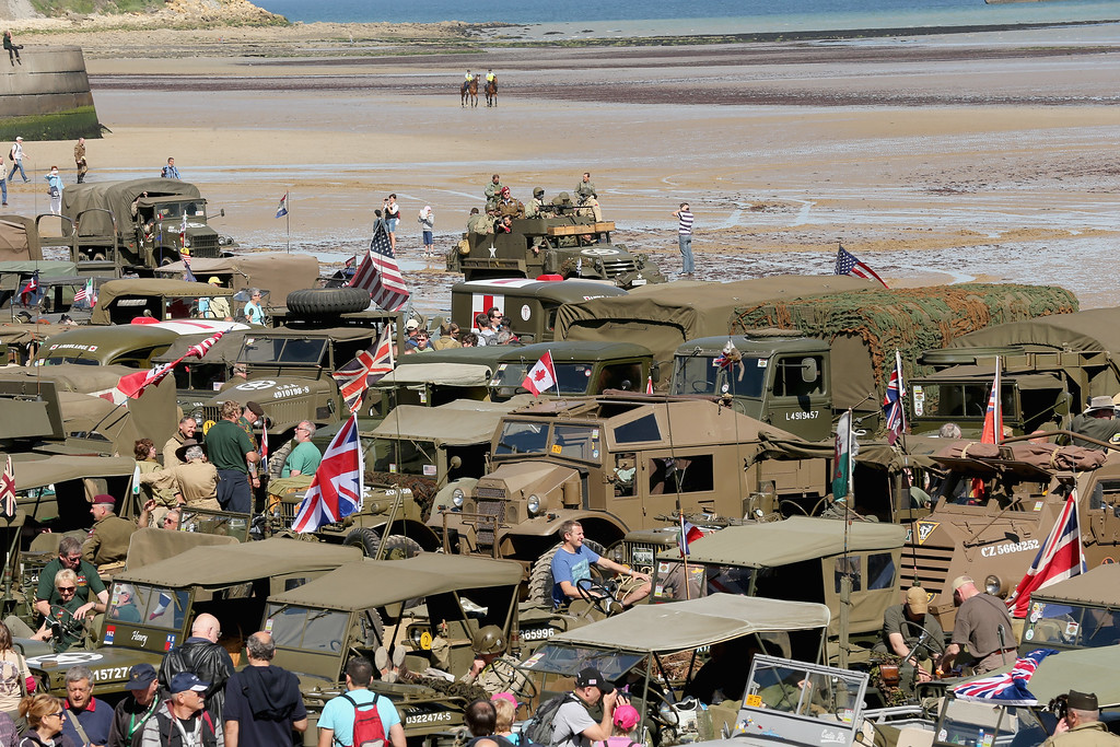 Description of . WWII military vehicles and enthusiasts muster on Gold Beach at Arromanche to commemorate the 70th anniversary of the D-Day landings on June 6, 2014 in Arromanches Les Bains, France.   (Photo by Christopher Furlong/Getty Images)