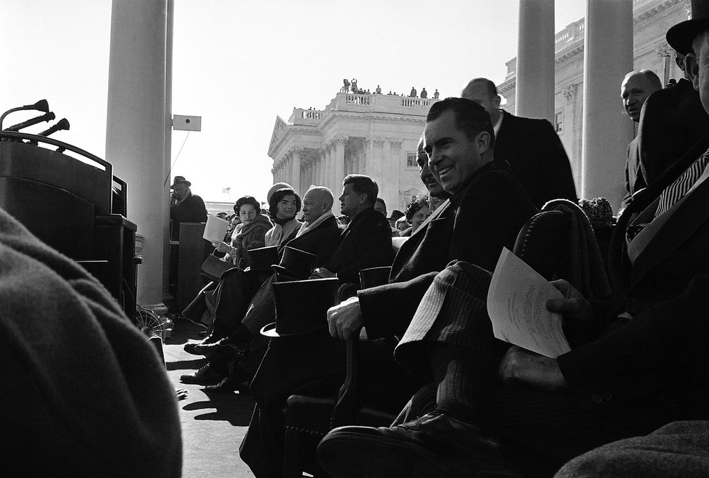 Description of . This was the view of front row seats in the inaugural stand before the administration of Democrat John F. Kennedy took over from that of Republican President Dwight Eisenhower. From left: Mrs. Lyndon B. Johnson, wife of new vice-president; Mrs. John F. Kennedy, wife of president-elect; Eisenhower; John F. Kennedy, who took oath as president a few minutes later. Lyndon B. Johnson, the new vice president. At right is Richard Nixon who was Kennedy's opponent in the election. (AP Photo)