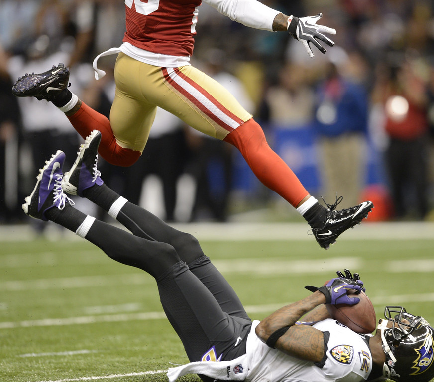 Description of . Jacoby Jones (R) of the Baltimore Ravens falls with the ball in the second quarter against the San Francisco 49ers during Super Bowl XLVII at the Mercedes-Benz Superdome on February 3, 2013 in New Orleans, Louisiana.   TIMOTHY A. CLARY/AFP/Getty Images