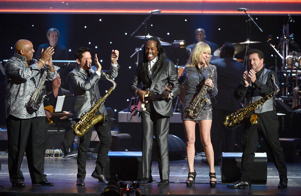 Description of . (L-R) Musicians Gerald Albright, Dave Koz, Verdine White, Mindi Abair and Richard Elliot perform with the Larry Batiste Orchestra onstage during the 56th GRAMMY Awards Pre-Telecast Show at Nokia Theatre L.A. Live on January 26, 2014 in Los Angeles, California.  (Photo by Kevork Djansezian/Getty Images)