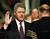 President Clinton is sworn in for his second term by Supreme Court Chief Justice William Rehnquist during the 53rd Presidential Inauguration Monday, Jan. 20, 1997, in Washington.  (AP Photo/J. Scott Applewhite)