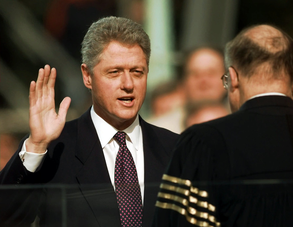Description of . President Clinton is sworn in for his second term by Supreme Court Chief Justice William Rehnquist during the 53rd Presidential Inauguration Monday, Jan. 20, 1997, in Washington.  (AP Photo/J. Scott Applewhite)