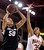 University of Colorado's Jamee Swan takes a shot over Desiree Hunter during a games against the University of Denver on Tuesday, Dec. 11, at the Magnus Arena on the DU campus in Denver.   (Jeremy Papasso/Daily Camera)
