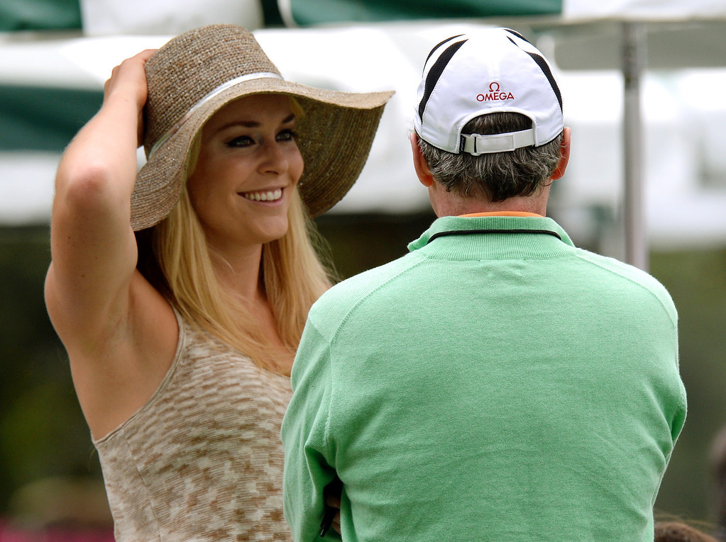 Description of . US skier Lindsey Vonn waits at the clubhouse for Tiger Woods of the US to tee off during the first round of the 77th Masters golf tournament at Augusta National Golf Club on April 11, 2013 in Augusta, Georgia.    DON EMMERT/AFP/Getty Images