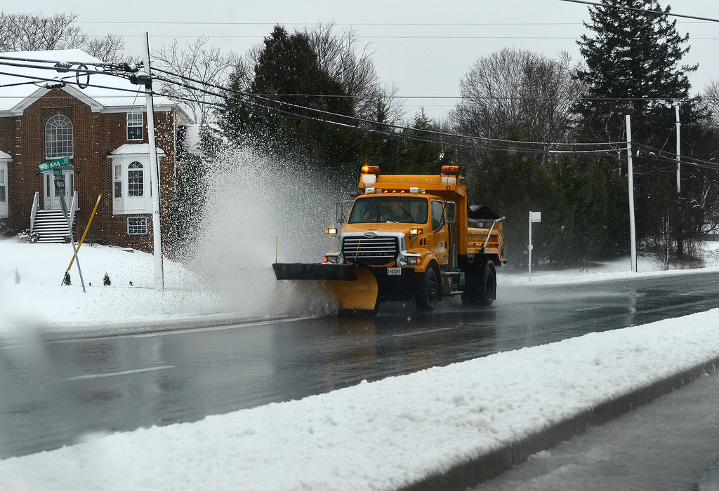 Description of . A snow truck sweeps snow from a road in Silver Spring, Maryland, on March 6, 2013.  AFP PHOTO/Jewel SAMAD/AFP/Getty Images