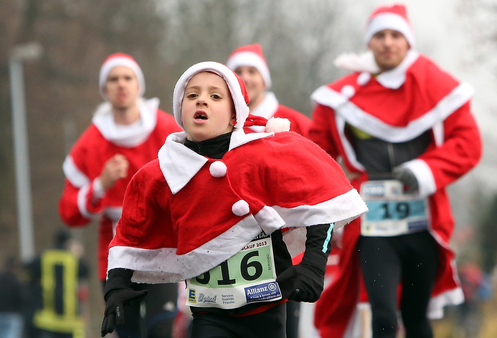 Description of . Participants compete in 5th annual Michendorf Santa Run (Michendorfer Nikolauslauf) on December 8, 2013 in Michendorf, Germany. Over 900 people took part in this year's races, which included one for children and one for adults.  (Photo by Adam Berry/Getty Images)