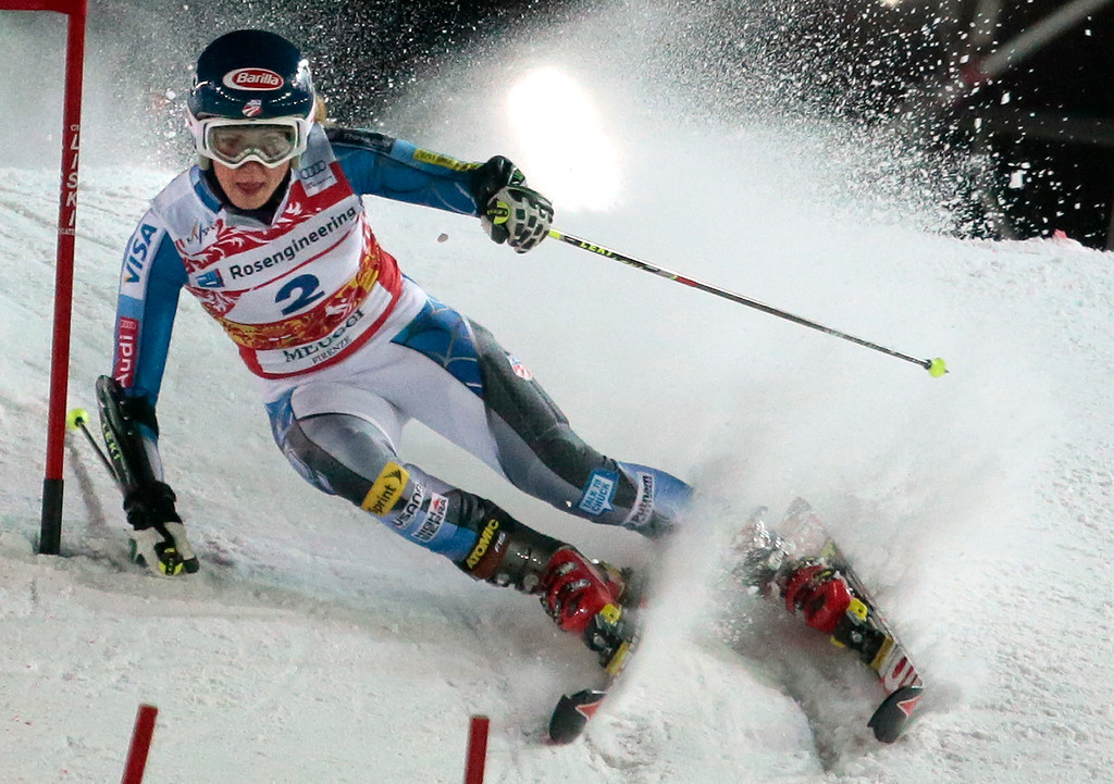 Description of . Third placed Mikaela Shiffrin of  USA passes a gate during the women's parallel slalom at the FIS Ski World Cup in Moscow, Russia, Tuesday, Jan. 29, 2013. (AP Photo/Mikhail Metzel)