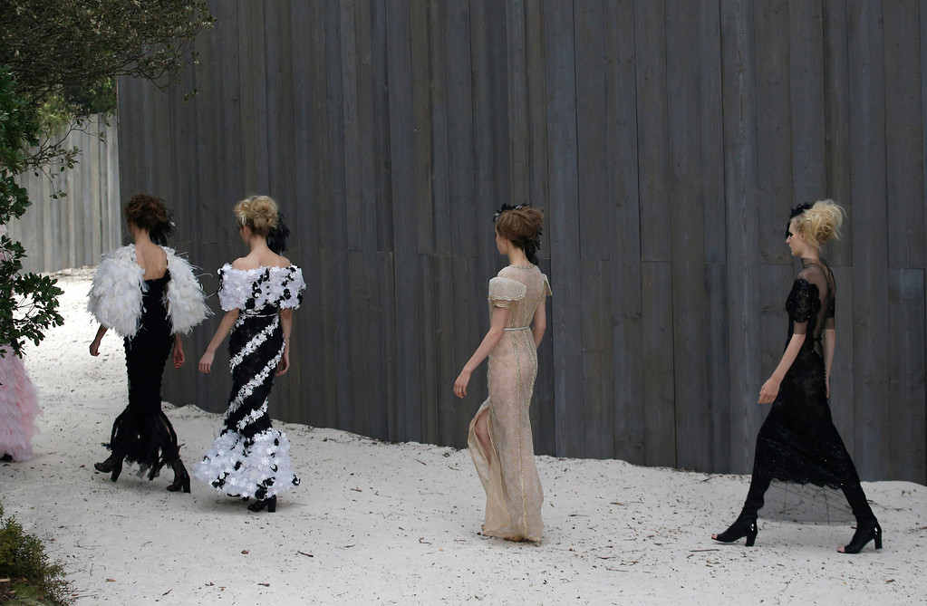Description of . Models wear creations by German fashion designer Karl Lagerfeld for Chanel's Spring Summer 2013 Haute Couture fashion collection, presented in Paris, Tuesday, Jan.22, 2013. (AP Photo/Christophe Ena)