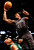 Brooklyn Nets forward Gerald Wallace (45) fouls Boston Celtics forward Jared Sullinger (7) while shooting in the first half of their NBA basketball game at Barclays Center, Tuesday, Dec. 25, 2012, in New York. (AP Photo/John Minchillo)