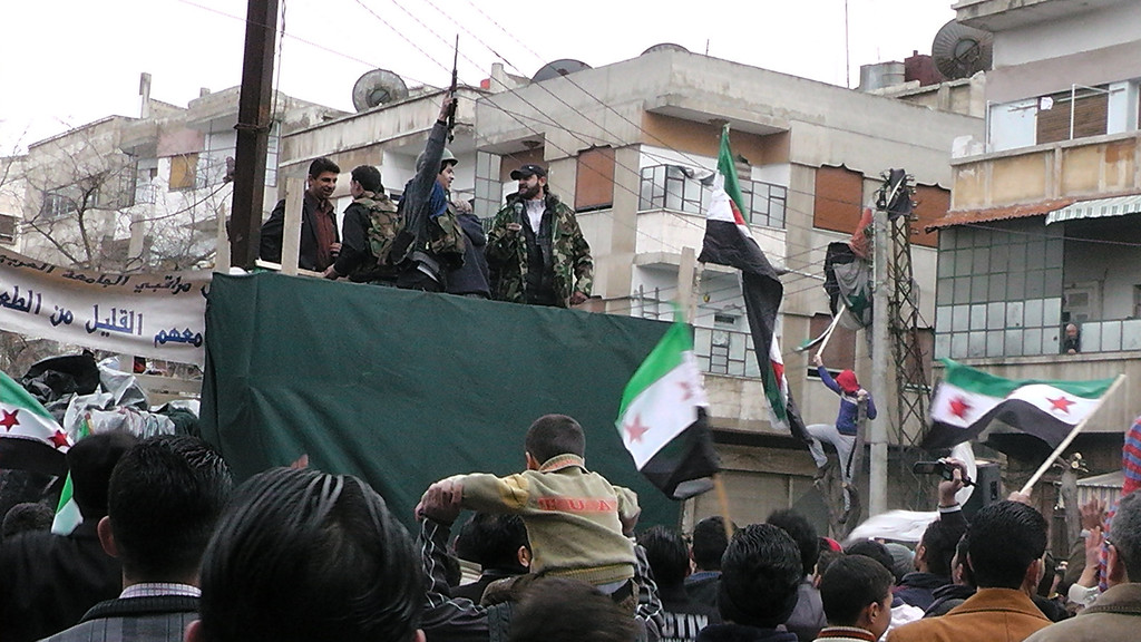 Description of . Members of the Free Syrian Army (FSA) and their supporters gather in the Khalidiya neighborhood of the flashpoint city of Homs on January 13, 2012 as thousands protested in support of the rebels throughout the country. The rallies came after the largest civilian opposition group decided to boost cooperation with the rebel armed group, formed from deserters from the regular army who mutinied over the regime's deadly crackdown. The FSA says it has some 40,000 fighters under its command. -/AFP/Getty Images