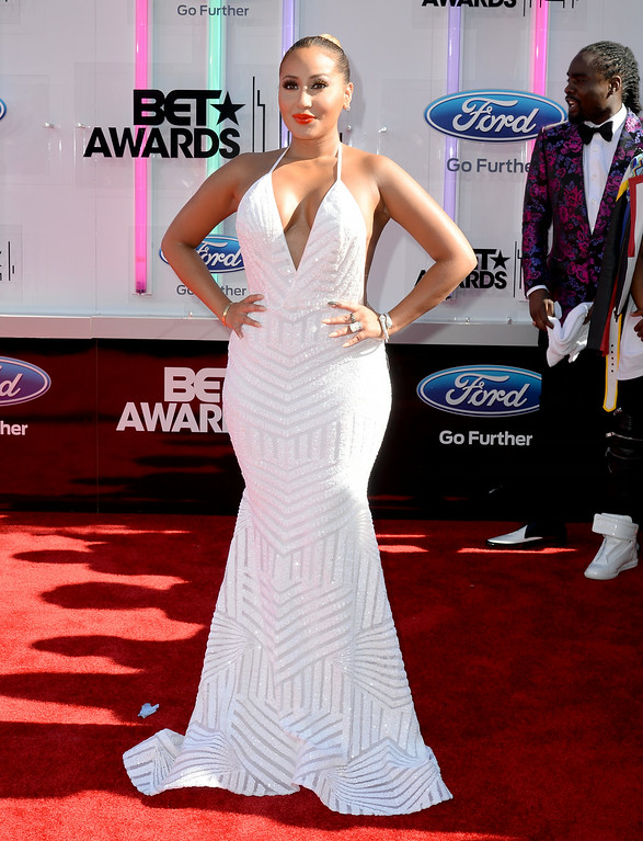 Description of . Singer-songwriter Adrienne Bailon attends the BET AWARDS '14 at Nokia Theatre L.A. LIVE on June 29, 2014 in Los Angeles, California.  (Photo by Earl Gibson III/Getty Images for BET)
