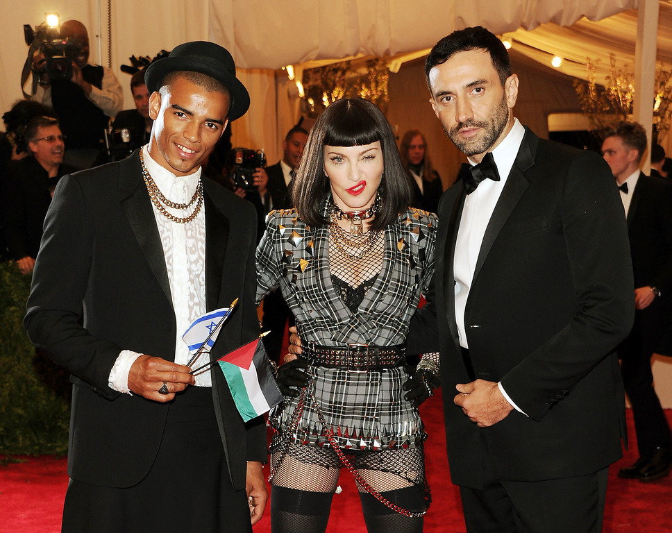 Description of . Brahim Zaibat, left,recording artist Madonna and designer Riccardo Tisci attend The Metropolitan Museum of Art's Costume Institute benefit celebrating