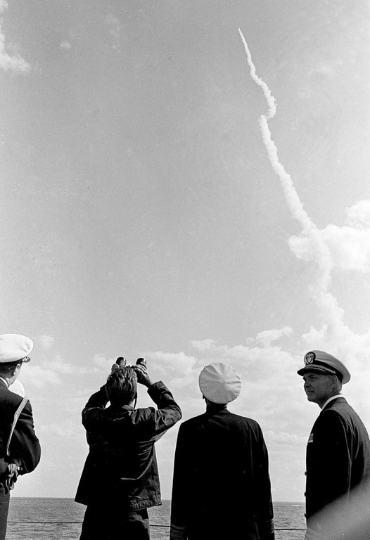 Description of . President Kennedy uses binoculars to view a  Polaris missile that was fired from a 30 miles off Cape Canaveral, Fla., on Nov. 16, 1963.  Associated Press file