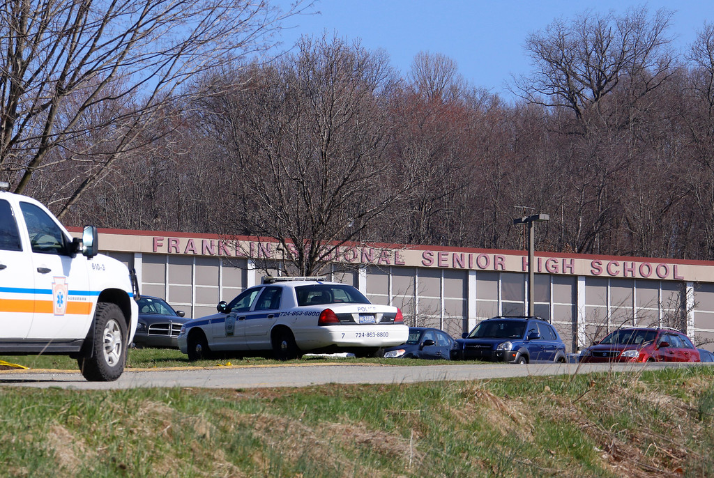 Description of . Emergency vehicles are parked around Franklin Regional High School, where several people were stabbed on Wednesday, April 9, 2014, in Murrysville, Pa., near Pittsburgh. The suspect, a male student, was taken into custody and being questioned. (AP Photo/Gene Puskar)