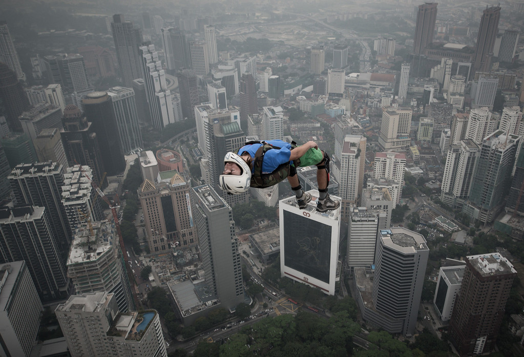 Description of . Base jumper Denis Odintsov from Russian leaps from the 300-meters Open Deck of the Malaysia's landmark Kuala Lumpur Tower during the International Tower Jump in Kuala Lumpur on September 27, 2013. Some 103 professional base jumpers from 20 countries are taking part in the annual event. AFP PHOTO / MOHD RASFAN/AFP/Getty Images