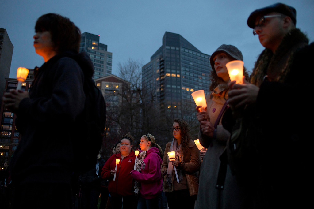 . People stand during a vigil honoring the victims of Boston Marathon bombings at the Boston Common in Boston, Massachusetts April 16, 2013. A pressure cooker stuffed with gunpowder and shrapnel caused at least one of the blasts at the Boston Marathon that killed three people and injured 176 others in the worst attack on U.S. soil since Sept. 11, 2001, law enforcement sources said on Tuesday. REUTERS/Shannon Stapleton