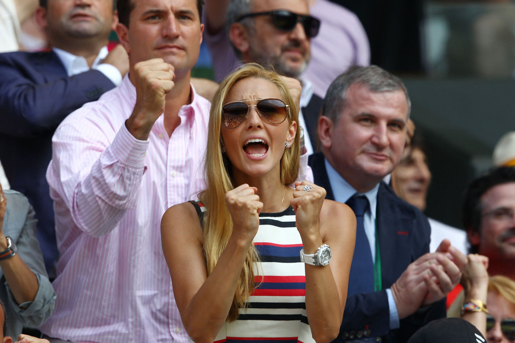Description of . Jelena Ristic, the girlfriend of Novak Djokovic of Serbia cheers during his Gentlemen's Singles Final match against Andy Murray of Great Britain on day thirteen of the Wimbledon Lawn Tennis Championships at the All England Lawn Tennis and Croquet Club on July 7, 2013 in London, England.  (Photo by Clive Brunskill/Getty Images)