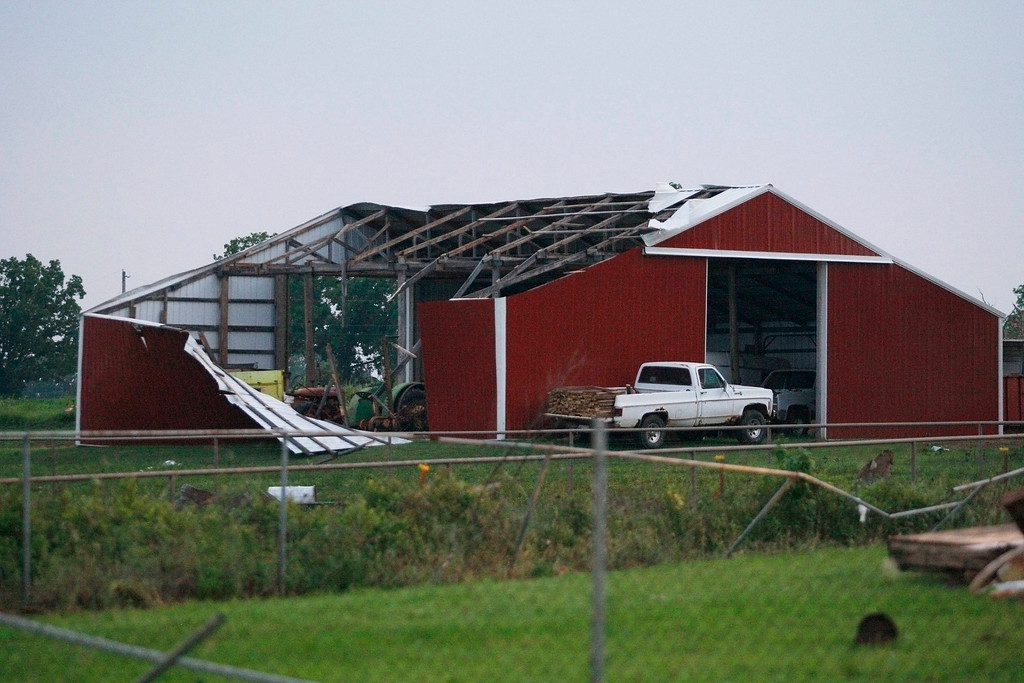 Description of . A barn's roof and siding is torn off after a tornado swept through west of Shawnee, Oklahoma on May 19, 2013. A tornado half a mile wide struck near Oklahoma City on Sunday, part of a massive storm front that hammered the central United States. News reports said at least one person had died. REUTERS/Bill Waugh