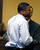 Ma'lik Richmond, left, is helped by Fred Abdalla Jr., chief probation officer for the Jefferson County juvenile court, as he reacts while apologizing to the victim and her family in juvenile court in Steubenville, Ohio, March 17, 2013. Trent Mays and  Richmond were found guilty of raping a 16-year-old girl at a party last summer while she was in a drunken stupor in a case that gained national exposure through social media. REUTERS/Keith Srakocic/Pool