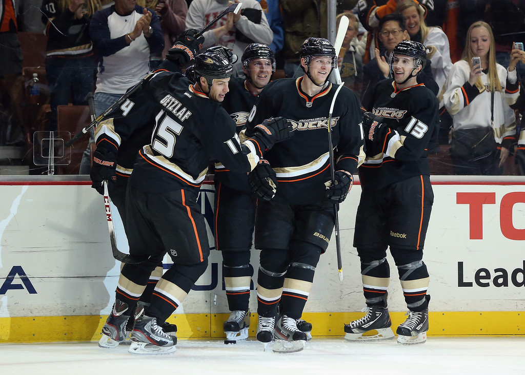 Description of . (L-R) Ryan Getzlaf #15, Francois Beauchemin #23, Corey Perry #10 and Nick Bonino #13 of the Anaheim Ducks celebrate Getzlaf's goal in the third period against the Colorado Avalanche at Honda Center on February 24, 2013 in Anaheim, California. The Ducks defeated the Avalanche 4-3 in overtime.  (Photo by Jeff Gross/Getty Images)