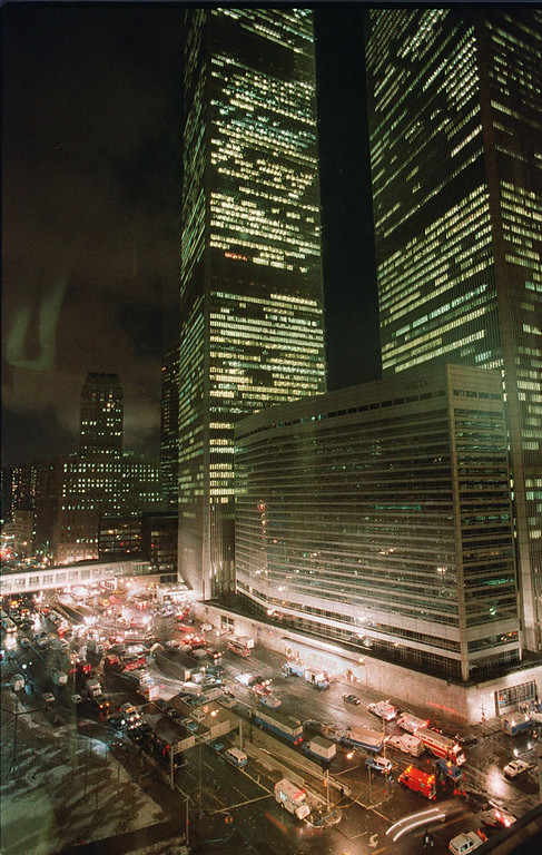 Description of . Fire, police and other emergency vehicles block the street near the twin towers of New York's World Trade Center after an explosion occurred in the underground parking garage on Feb. 26, 1993.  Reflecting on the 10-year anniversary of the bombing, two top law enforcement officials said the nation badly underestimated the terrorist threat to come. (AP Photo/George Widman)