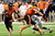Storm Woods #24 of the Oregon State Beavers avoids a tackle by Tevin Jackson #11 of the University of Texas Longhorns during the Valero Alamo Bowl at the Alamodome on December 29, 2012 in San Antonio, Texas.  (Photo by Stacy Revere/Getty Images)
