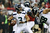 Russell Wilson #3 of the Seattle Seahawks looks to pass against the Atlanta Falcons in the first quarter of the NFC Divisional Playoff Game at Georgia Dome on January 13, 2013 in Atlanta, Georgia.  (Photo by Streeter Lecka/Getty Images)