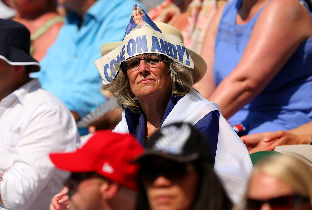 Description of . A spectator on Centre Court wearing a paper hat displaying a message in support of Andy Murray of Great Britain during his Gentlemen's Singles Final match against Novak Djokovic of Serbia on day thirteen of the Wimbledon Lawn Tennis Championships at the All England Lawn Tennis and Croquet Club on July 7, 2013 in London, England.  (Photo by Julian Finney/Getty Images)