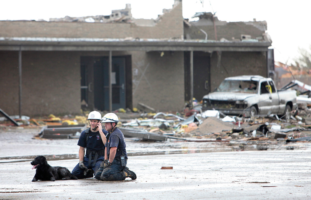 . Searchers rest outside the Briarwood Elementary School after the tornado destroyed the school , Monday,  May 20, 2013. (AP Photo/ The Oklahoman,  David McDaniel)