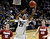 University of Colorado's Andre Roberson goes for a layup over Rosco Allen, No. 12, and John Gage, No. 40, during a game against Stanford on Thursday, Jan. 24, at the Coors Event Center on the CU campus in Boulder.  