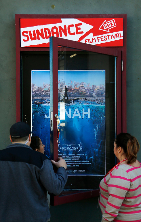 Description of . Workers install a movie poster at the Egyptian Theatre on Main Street during the 2013 Sundance Film Festival on Thursday, Jan. 17, 2013 in Park City, Utah. (Photo by Danny Moloshok/Invision/AP)