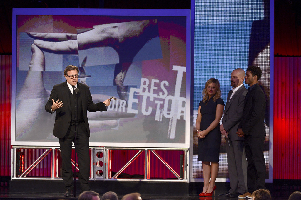 Description of . SANTA MONICA, CA - FEBRUARY 23: Director David O. Russell accepts the Best Director award for 'Silver Linings Playbook' from presenters Amy Poehler and Bryan Cranston onstage during the 2013 Film Independent Spirit Awards at Santa Monica Beach on February 23, 2013 in Santa Monica, California.  (Photo by Kevork Djansezian/Getty Images)