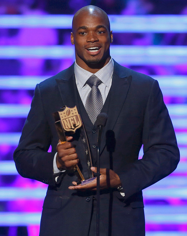 Description of . Minnesota Vikings running back Adrian Peterson accepts the award for the NFL Fantasy Player of the Year during the NFL Honors award show in New Orleans, Louisiana February 2, 2013.    REUTERS/Jeff Haynes