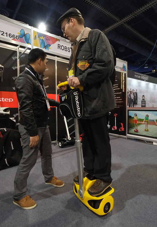Description of . A man tries A Robostep Robot during the 2014 International CES at the Las Vegas Convention Center on January 8, 2014 in Las Vegas, Nevada. CES, the world's largest annual consumer technology trade show, runs through January 10 and is expected to feature 3,200 exhibitors showing off their latest products and services to about 150,000 attendees. AFP PHOTO/JOE KLAMAR/AFP/Getty Images
