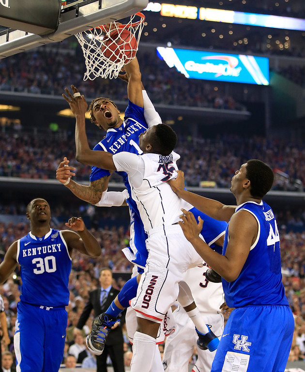 Description of . ARLINGTON, TX - APRIL 07:  James Young #1 of the Kentucky Wildcats dunks over Amida Brimah #35 of the Connecticut Huskies during the NCAA Men\'s Final Four Championship at AT&T Stadium on April 7, 2014 in Arlington, Texas.  (Photo by Jamie Squire/Getty Images)