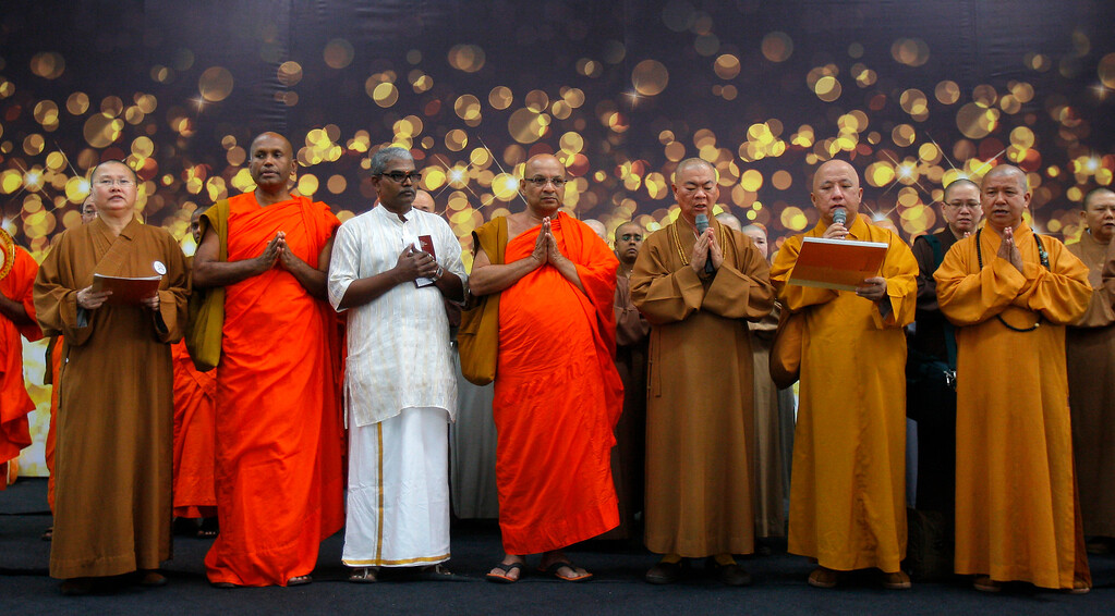 Description of . Buddhist monks offer a special prayer for passengers aboard a missing plane, at Kuala Lumpur International Airport in Sepang, Malaysia, Sunday, March 9, 2014. Military radar indicates that the missing Boeing 777 jet of Malaysia Airlines may have turned back, Malaysiaís air force chief said Sunday as scores of ships and aircraft from across Asia resumed a hunt for the plane and its 239 passengers. (AP Photo/Lai Seng Sin)