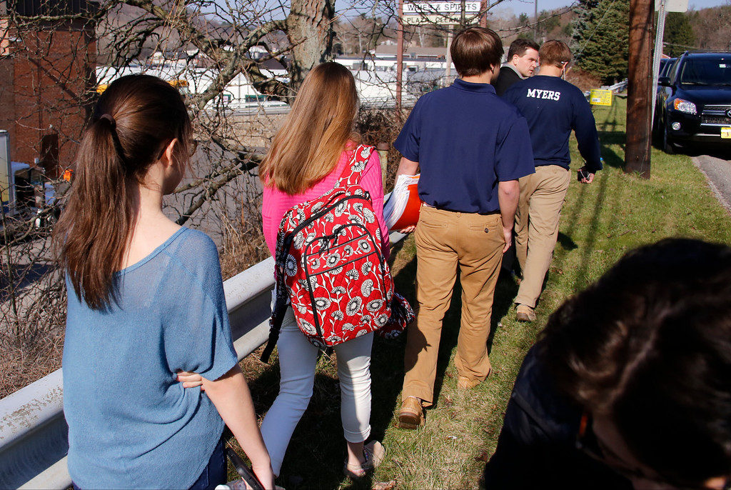 Description of . Students leave the campus of the Franklin Regional School District where several people were stabbed at Franklin Regional High School on Wednesday, April 9, 2014, in Murrysville, Pa., near Pittsburgh. The suspect, a male student, was taken into custody and being questioned. (AP Photo/Gene Puskar)