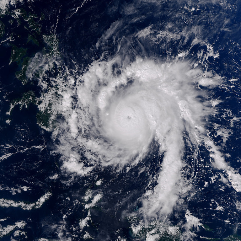 . This Earth Observatory image made on Dec. 3, 2012, provided by NASA shows Typhoon Bopha moving toward the Philippines. Typhoon Bopha slammed into the Davao region of the Philippines early Tuesday, Dec. 4, killing at least seven people and forcing more than 50,000 to flee from inundated villages. (AP Photo/NASA, Jesse Allen)