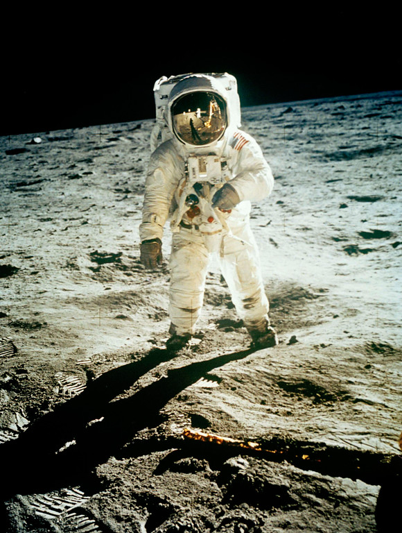 Description of . FILE - In this July 20, 1969 file photo from NASA,  Astronaut Edwin E. Aldrin Jr., lunar module pilot, is photographed walking near the lunar module during the Apollo 11 extravehicular activity. (AP Photo, NASA ,file)