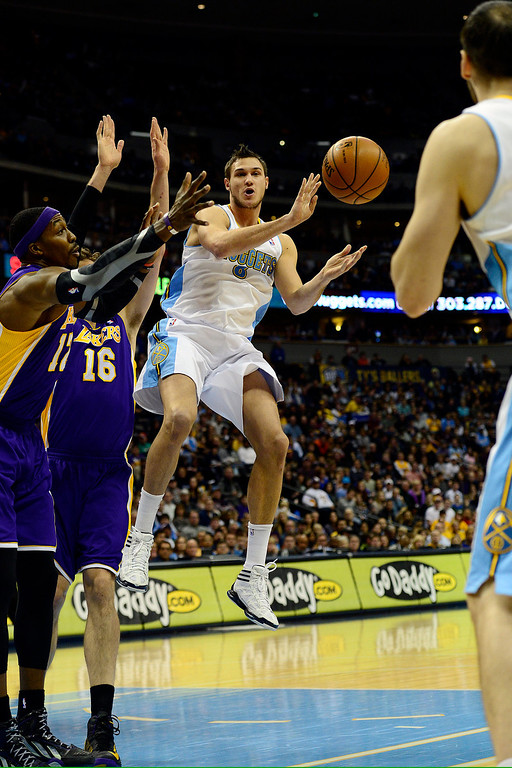 Description of . Denver Nuggets small forward Danilo Gallinari (8) passes the ball in traffic against the Los Angeles Lakers defense during the first half at the Pepsi Center on Wednesday, December 26, 2012. AAron Ontiveroz, The Denver Post