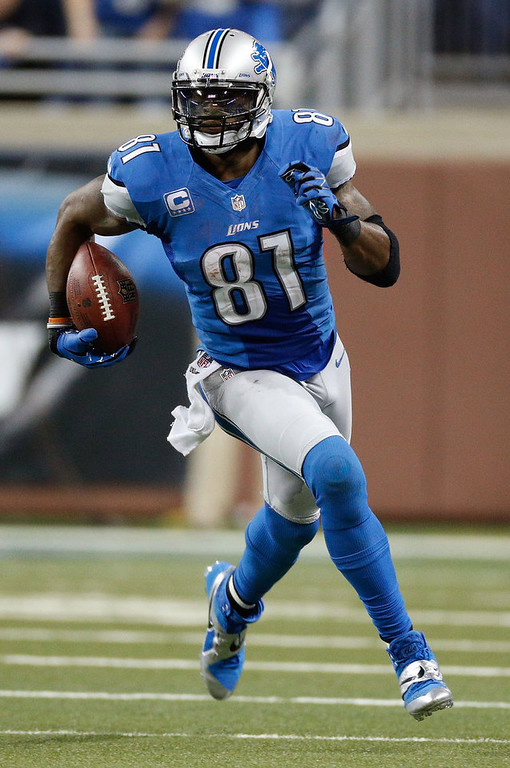 Description of . Calvin Johnson #81 of the Detroit Lions runs for 26 yards after a fourth quarter catch while playing the Atlanta Falcons at Ford Field on December 22, 2012 in Detroit, Michigan.  Johnson broke the NFL single season yardage record formally held by Jerry Rice during this play. (Photo by Gregory Shamus/Getty Images)