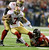 Atlanta Falcons' Corey Peters (91) sacks San Francisco 49ers' Colin Kaepernick (7) during the first half of the NFL football NFC Championship game Sunday, Jan. 20, 2013, in Atlanta. Trying to hold up Kaepernick is 49ers' Mike Iupati. (AP Photo/David Goldman)