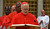 In this image made from video provided by Vatican CTV television, Brazilian Cardinal Odilo Pedro Scherer, of Brazil, right, takes an oath of secrecy inside the Sistine Chapel, at the Vatican, Tuesday, March 12, 2013, before the start of the conclave to elect the 266th Roman Catholic Church pope. Behind Scherer are Cardinals John Njue, of Kenya, Raul Eduardo Vela Chiriboga, of Ecuador, and Laurent Monsengwo Pasinya, of the Democratic Republic of Congo.  (AP Photo/CTV via APTV)