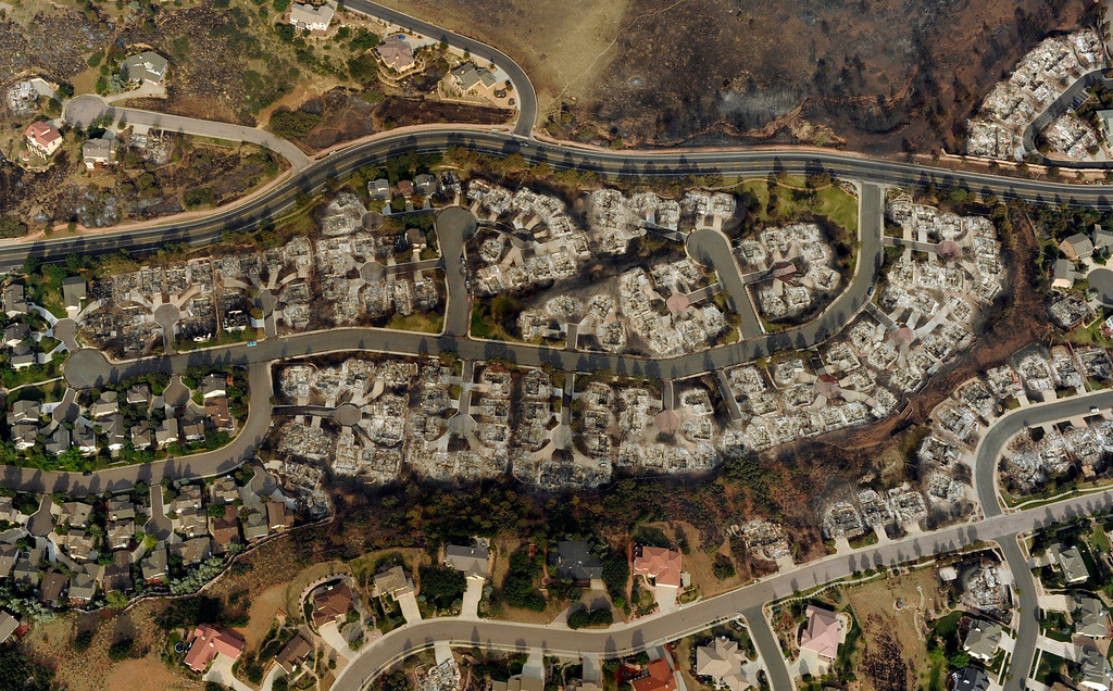 Description of . An aerial photo, taken on Thursday, June 28, 2012, of the Waldo Canyon fire in Colorado Springs shows the destructive path of the fire in the Mountain Shadows Subdivision area. RJ Sangosti, The Denver Post