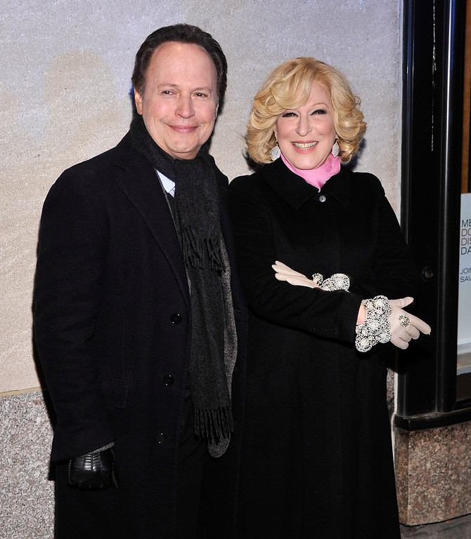 Description of . Actors Billy Crystal and Bette Midler attend the 80th Annual Rockefeller Center Christmas Tree Lighting Ceremony on November 28, 2012 in New York City.  (Photo by Stephen Lovekin/Getty Images)
