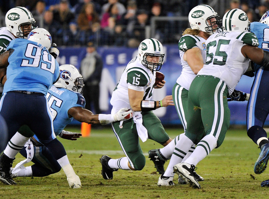 Description of . NASHVILLE, TN - DECEMBER 17:   Quarterback Tim Tebow #15 of the New York Jets is sacked by Zach Brown #55 of the Tennessee Titans at LP Field on December 17, 2012 in Nashville, Tennessee.  (Photo by Frederick Breedon/Getty Images)